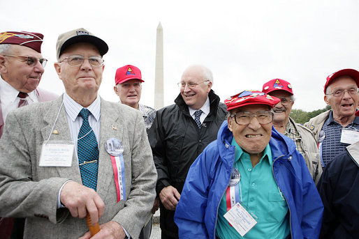 "Vice President Dick Cheney poses for a photo with veterans from the 526th Armored Infantry Battalion Friday, Oct. 7, 2005, after delivering remarks during a wreath -laying ceremony at the National World War II Memorial in Washington D.C. ""I count it a privilege to stand in the presence of men who were sent into battle by President Franklin D. Roosevelt.and who, by your courage and honor and devotion to duty, helped to win a war and change the course of history"", said the Vice President to the soldiers, widows, and family members of the 526th Armored Infantry Battalion who attended the ceremony. The 526th AIB is the sole remaining, separate armored infantry battalion from World War II, whose soldiers defended the Belgian villages of Stavelot and Malmedy on December 16, 1944, the first day of the Battle of the Bulge. White House photo by David Bohrer"