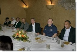 President George W. Bush, center, is seen Monday evening, Oct. 10, 2005 at the restaurant Bacco in New Orleans, La., sitting next to U. S. Coast Guard Vice Admiral Thad W. Allen, New Orleans Mayor Ray Nagin and joined by other local officials.  White House photo by Eric Draper