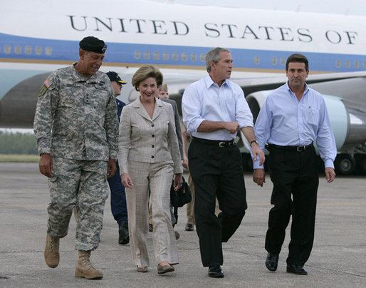 President George W. Bush and Laura Bush walk with Lt. General Russell Honore, left, and Plaquemines Parish president Benny Rousselle, right, upon their arrival Monday, Oct. 10, 2005 at the U.S. Naval Air Station, Joint Reserve Base in New Orleans, La. White House photo by Eric Draper