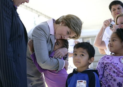 Laura Bush gives a hug to a student at Delisle Elementary School in Pass Christian, Miss., Tuesday, Oct. 11, 2005, as the school reopened for the first time since the area was struck by Hurricane Katrina. White House photo by Eric Draper