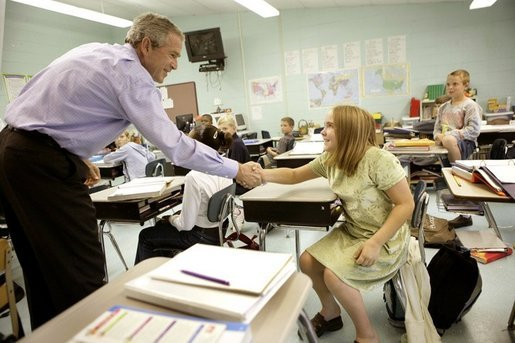 President George W. Bush introduces himself to a student Tuesday, Oct. 11, 2005 at Delisle Elementary School in Pass Christian, Miss., the school reopened Tuesday for the first time since Hurricane Katrina devastated the Gulf Coast region. White House photo by Eric Draper