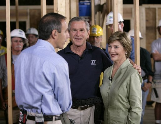 "NBC ""Today Show"" host Matt Lauer talks with President George W. Bush and Laura Bush Tuesday, Oct. 11, 2005, on the construction site of a Habitat for Humanity home in Covington, La., a hurricane-devastated town just north of New Orleans where the nonprofit is building houses for those displaced by Katrina. White House photo by Eric Draper"