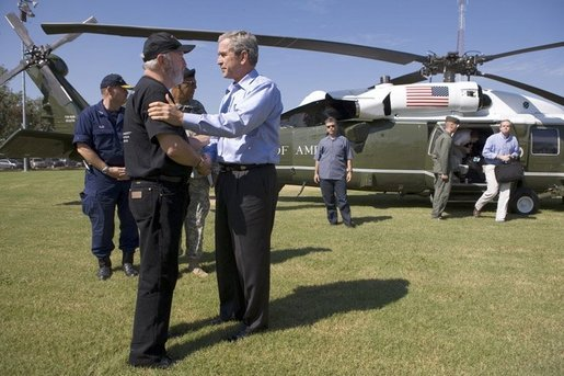 President George W. Bush is greeted by Jefferson Parish president Aaron Broussard upon his arrival Tuesday, Oct. 11, 2005 to New Orleans aboard Marine One. White House photo by Eric Draper