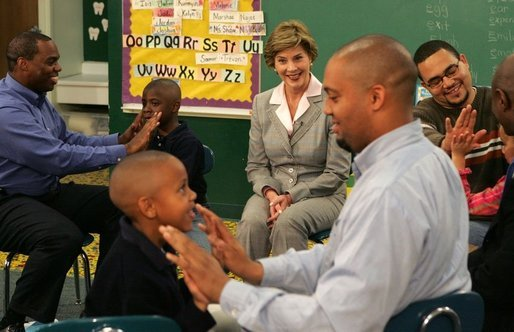 Laura Bush watches fathers play a game with their children in the R.E.A.D. to Kids Training Program at J.S. Chick Elementary School in Kansas City, Mo., Tuesday, October 11, 2005. White House photo by Krisanne Johnson