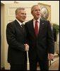 President George W. Bush welcomes Poland's President Aleksander Kwasniewski to the Oval Office at the White House, Wednesday, Oct. 12, 2005 in Washington. White House photo by Eric Draper