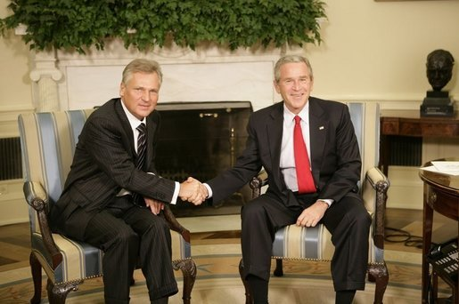 President George W. Bush and Poland's President Aleksander Kwasniewski shake hands as they meet with reporters in the Oval Office at the White House, Wednesday, Oct. 12, 2005 in Washington. White House photo by Eric Draper