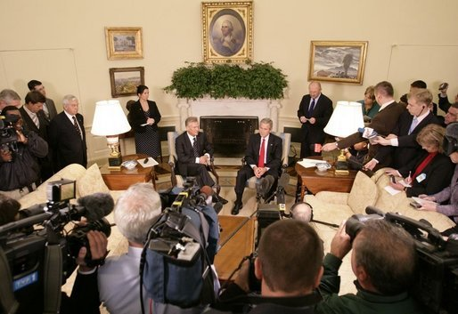 President George W. Bush and Poland's President Aleksander Kwasniewski meet with reporters in the Oval Office at the White House, Wednesday, Oct. 12, 2005 in Washington. White House photo by Eric Draper