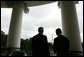 President George W. Bush and Poland's President Aleksander Kwasniewski look toward the Washington Monument, as they stand together on the Truman Balcony at the White House, Wednesday, Oct. 12, 2005 in Washington. White House photo by Eric Draper