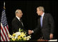 President George W. Bush shakes hands with Pakistan's Ambassador Jehangir Karamat, after signing a book of condolences, Friday, Oct. 14, 2005 at the Pakistan Embassy in Washington, to express the condolences of the American people for those who suffered as a result of the recent earthquake that struck Pakistan. White House photo by Eric Draper