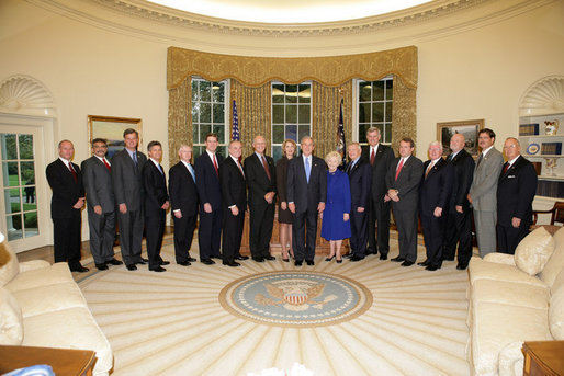 President George W. Bush poses in the Oval Office with recipients of the Secretary of Defense Employer Support Freedom Award, Friday, Oct. 14, 2005 at the White House in Washington. The award is recognition for providing exceptional support to their National Guard and Reserve employees. White House photo by Paul Morse