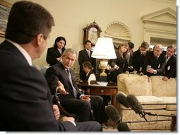 President George W. Bush gestures to Bulgarian President Georgi Purvanov as they take questions from reporters, Monday, Oct. 17, 2005, in the Oval Office at the White House in Washington.  White House photo by Eric Draper