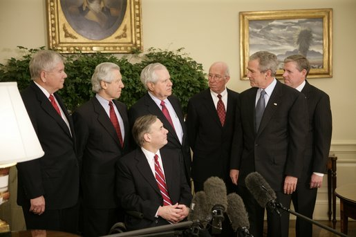 President George W. Bush meets with former justices of the Texas Supreme Court Monday, Oct. 17, 2005, in the Oval Office of the White House. From left are: Former Associate Justice Eugene Cook; former Associate Justice Raul Gonzalez; Texas Attorney General and former Associate Justice Greg Abbott, seated; former Texas Chief Justice John Hill; former Associate Justice James Baker; the President, and former Associate Justice Craig Enoch. White House photo by Eric Draper