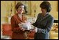 Laura Bush presents Mrs. Zorka Parvanova, First Lady of the Republic of Bulgaria, Monday, October 17, 2005, with signed children's books for the shelves of Sofia City Public Library in Sofia City, Bulgaria. White House photo by Krisanne Johnson