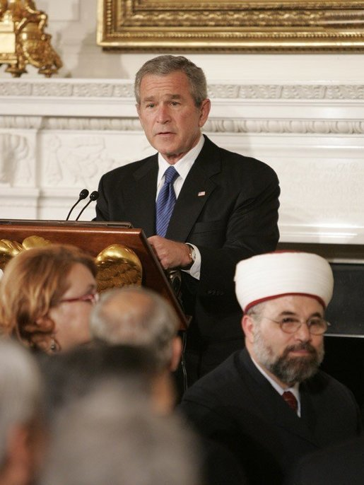 President George W. Bush welcomes guests to the Iftaar Dinner with Ambassadors and Muslim Leaders, held in the State Dining Room of the White House, Monday, Oct. 17, 2005 in Washington. White House photo by Paul Morse