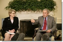 President George W. Bush and U.S. Secretary of Education Margaret Spellings meet with reporters, Wednesday, Oct. 19, 2005 in the Oval Office at the White House to discuss the Nation's Report Card.  White House photo by Eric Draper