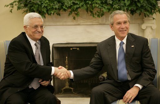 President George W. Bush welcomes Mahmoud Abbas, President of the Palestinian Authority, to the Oval Office Thursday, Oct. 20, 2005. White House photo by Eric Draper