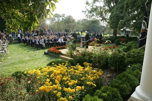 President George W. Bush and President Mahmoud Abbas, of the Palestinian Authority, stand before the media Thursday, Oct. 20, 2005, during a joint availability in the Rose Garden of the White House. White House photo by Paul Morse