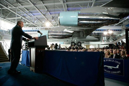 President George W. Bush stands before the Boeing 707 aircraft that served President Ronald Reagan and six other presidents, as he addresses an audience at the Ronald Reagan Presidential Library, Friday, Oct. 21, 2005 in Simi Valley, Calif., at the dedication of the Air Force One Pavilion. White House photo by Eric Draper