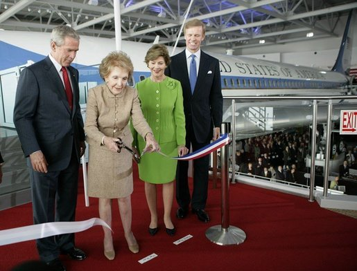 President George W. Bush and Laura Bush join Nancy Reagan, Friday, Oct. 21, 2005, as she cuts the ribbon to officially open the Air Force One Pavilion at the Ronald Reagan Library in Simi Valley, Calif., featuring the Boeing 707 aircraft that served President Ronald Reagan and six other presidents. Fred Ryan Jr. of the Ronald Reagan Presidential Foundation is seen at right. White House photo by Eric Draper