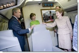 President George W. Bush, Mrs. Bush and Nancy Reagan tour the plane that served as Air Force One for President Reagan and six other Presidents from 1973 to 2001 at the Ronald Reagan Presidential Library in Simi Valley, California, Friday, Oct. 21, 2005. White House photo by Eric Draper