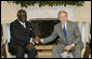 President George W. Bush welcomes Ghana President John A. Kufuor to the Oval Office at the White House, Wednesday, Oct. 26, 2005. President Kufuor arrived in Washington this week to promote trade, investment and tourism in Ghana. White House photo by Eric Draper