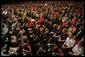 An audience listens to President George W. Bush, Friday, Oct. 28, 2005 at Chrysler Hall in Norfolk, Va., speaking on the successes and challenges in fighting the war on terror. White House photo by Paul Morse