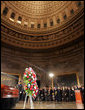 President George W. Bush and Laura Bush honor Rosa Parks during a wreath-laying ceremony in the Rotunda of the U.S. Capitol in Washington, D.C., Sunday Oct. 30, 2005. The casket of Rosa Parks will rest in the U.S. Capitol until Monday evening. White House photo by Shealah Craighead