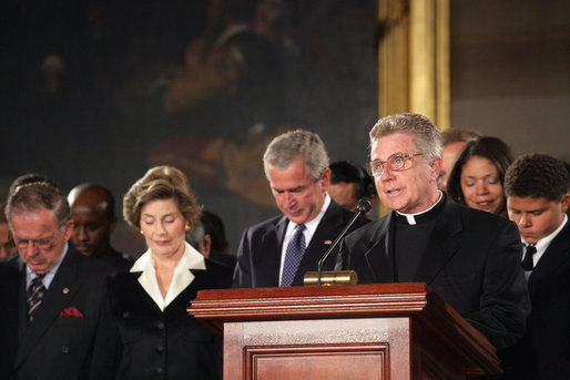 President George W. Bush and Laura Bush participate in a prayer led by Reverend Daniel Coughlin, House Chaplain, in honor of Rosa Parks during a wreath-laying ceremony in the Rotunda of the U.S. Capitol in Washington, D.C., Sunday Oct. 30, 2005. Rosa Parks passed away Monday, Oct. 24th. White House photo by Shealah Craighead