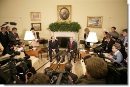 President George W. Bush talks to reporters during a visit with Italian Prime Minister Silvio Berlusconi in the Oval Office at the White House, Monday, Oct. 31, 2005 in Washington.  White House photo by Eric Draper