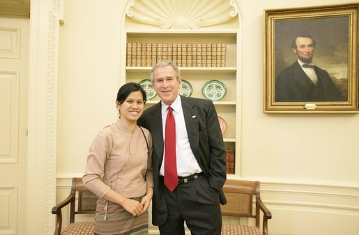 President George W. Bush welcomes activist Charm Tong of Burma to the Oval Office, Monday, Oct. 31, 2005, at the White House in Washington. White House photo by Eric Draper