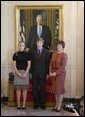 The family of Judge Samuel A. Alito, Jr., look on Monday, Oct. 31, 2005, as their father is nominated by President George W. Bush for Associate Justice of the U.S. Supreme Court. From left: daughter Laura, son, Phil, and wife, Martha. White House photo by Paul Morse