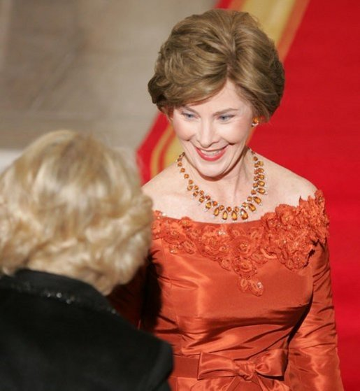 Laura Bush welcomes the Duchess of Cornwall upon the arrival of the Prince of Wales and the Duchess to the White House, Wednesday evening, Nov. 2, 2005. White House photo by Paul Morse