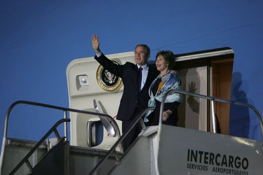 President George W. Bush and Laura Bush wave from Air Force One after landing Thursday, Nov. 3, 2005, in Mar del Plata, Argentina, where the President will participate in the Summit of the Americas. White House photo by Krisanne Johnson