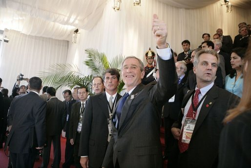 President George W. Bush gives the thumbs-up to well-wishers Friday, Nov. 4, 2005, as he attended the opening ceremonies of the 2005 Summit of the Americas at the Teatro Auditorium in Mar del Plata, Argentina. White House photo by Eric Draper
