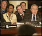 President George W. Bush, Secretary of State Condoleezza Rice and National Security Council Advisor Steve Hadley listen to opening statements Friday, Nov. 4, 2005, at the Summit of the Americas in Mar del Plata, Argentina. White House photo by Eric Draper