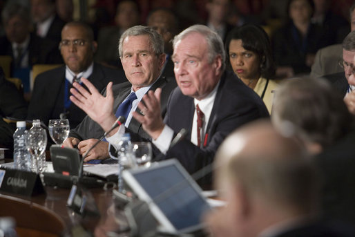President George W. Bush and Secretary of State Condoleezza Rice listen as Prime Minister Paul Marten of Canada speaks Friday, Nov. 4, 2005, during the opening session of the 2005 Summit of the Americas in Mar del Plata, Argentina. White House photo by Eric Draper