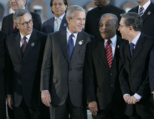 President George W. Bush is joined by leaders of the Americas Friday, Nov. 4, 2005, during the 2005 Summit of the Americas class photo in Mar del Plata, Argentina. Joining him in the front row are, from left: President Eduardo Rodriguez of Bolivia; Prime Minister Owen Arthur of Barbados; and Colombia President Alvaro Uribe. White House photo by Eric Draper