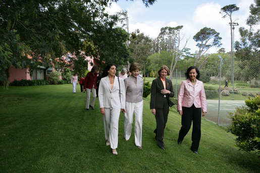 Mrs. Laura Bush walks with women leaders during her visit Friday, Nov. 4, 2005, to Estancia Santa Isabel, a ranch near Mar del Plata, site of the 2005 Summit of the Americas. White House photo by Krisanne Johnson