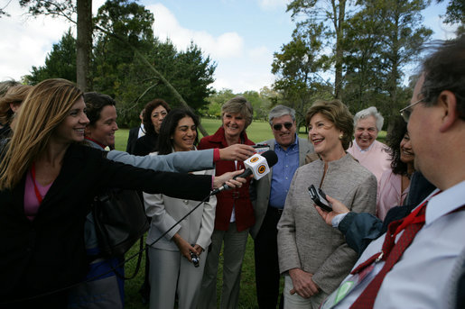 Mrs. Laura Bush smiles as she talks with the media after lunching Friday, Nov. 4, 2005, at Estancia Santa Isabel, an Argentine ranch located not far from Mar del Plata, where President George W. Bush was participating in the 2005 Summit of the Americas. White House photo by Krisanne Johnson