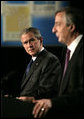 President George W. Bush listens to Argentina's President Nestor Carlos Kirchner as the two hold a joint press availability Friday, Nov. 4, 2005, at the Hermitage Hotel in Mar del Plata, Argentina. White House photo by Eric Draper