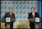 President George W. Bush and Argentina's President Nestor Carlos Kirchner smile as they hold a joint press availability Friday, Nov. 4, 2005, after meeting privately at the Hermitage Hotel in Mar del Plata, Argentina. White House photo by Paul Morse