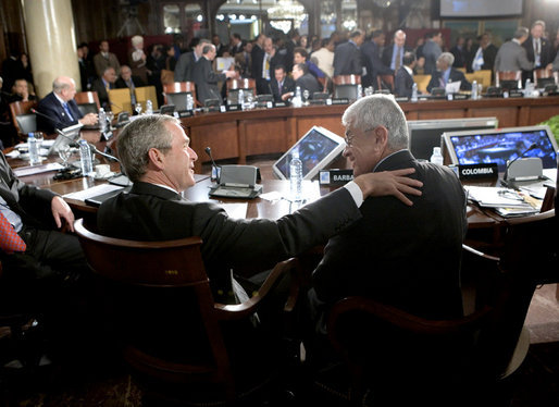 President George W. Bush shares a moment Saturday, Nov. 5, 2005, with President Alfredo Palacio of Ecuador during the final session of the 2005 Summit of the Americas in Mar del Plata, Argentina. White House photo by Eric Draper