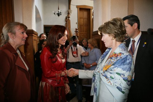Mrs. Cristina Fernandez de Kirchner welcomes Mrs. Laura Bush to a luncheon Saturday, Nov. 5, 2005, in Mar del Plata, Argentina. The event, hosted by the Argentine First Lady, included a display on Eva Peron and a photo exhibit of important Argentine women depicting their culture. White House photo by Krisanne Johnson