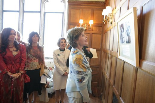 Mrs. Laura Bush looks over a photographic exhibit during a luncheon in Mar del Plata Saturday, Nov. 5, 2005, hosted by Argentine First Lady Mrs. Cristina Fernandez de Kirchner, far left. White House photo by Krisanne Johnson