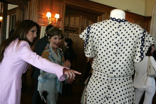 Mrs. Laura Bush is shown a dress worn by former Argentine First Lady Eva Peron as the U.S. First Lady participated in a luncheon Saturday, Nov. 5, 2005, in Mar del Plata that included a display of important Argentine women. White House photo by Krisanne Johnson