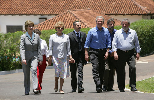 President George W. Bush and Brazil President Luiz Inacio Lula da Silva are joined by their wives, Laura Bush and Marisa Leticia da Silva, as they walk the grounds of President da Silva's Granja do Torto Saturday, Nov. 6, 2005. White House photo by Paul Morse