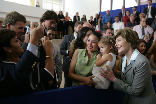 Laura Bush smiles as she greets staff and families at the U.S. Embassy in Brasilia, Brazil Saturday, Nov. 6, 2005.