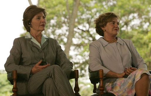 Mrs. Laura Bush and Mrs. Marisa Leticia da Silva listen to remarks by their husbands, during a joint statement at Granja do Torto, home of Brazil President Luiz Inacio Lula da Silva, Saturday, Nov. 6, 2005. White House photo by Paul Morse
