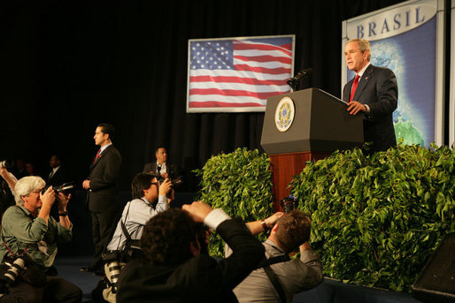 The media swarms President George W. Bush Saturday, Nov. 6, 2005, as he speaks at Blue Tree Stars Hall in Brasilia, Brazil, prior to his departure for Panama. White House photo by Krisanne Johnson