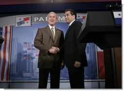 President George W. Bush greets President Martin Torrijos of Panama at the end of a joint press availability with the at Casa Amarilla in Panama City, Panama, Monday, Nov. 7, 2005. White House photo by Eric Draper
